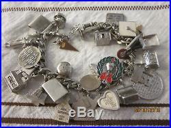 114 grams sterling silver 1960's charm bracelet 21 sterling charms 7.5 length