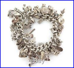 ABSOLUTELY STACKED c1980s STERLING SILVER CHARM BRACELET. APPROX 50 & 131 GRAMS