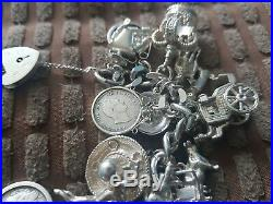 Antique sterling silver charm bracelet. Not scrap lots of charms 125 grams