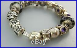 Authentic Pandora silver bracelet with 21 authentic silver charms purple colors