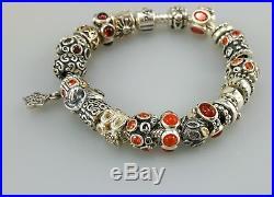 Authentic Pandora silver bracelet with 23 authentic silver charms orange colors