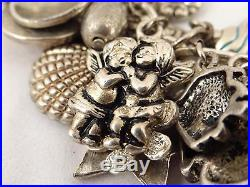 CHARM BRACELET With 40+ STERLING SILVER CHARMS ANGELS FLOWERS SHELLS, 143 grams