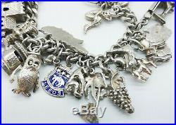 Fabulous Heavy Vintage Sterling Silver Charm Bracelet & 30 Good Charms. 86 gms