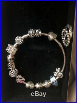 Genuine silver pandora bracelet with charms, bracelet rings. All stamped s925 ALE