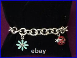 Genuine sterling silver Tiffany & Co bracelet with Daisy And Ladybug Charms