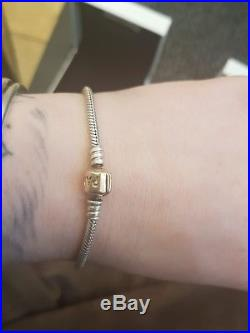 Pandora 14ct gold and silver charm bracelet