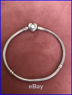 Pandora bracelet with charms used