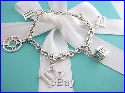 0efdf9501dd858 Rare Tiffany & Co Silver Atlas Charm Bracelet Bangle – Silver Charm ...