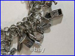 STUNNING Vintage Sterling Silver CHARM BRACELET 31 Charms 94.4 grams CHUNKY