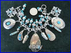 Sterling Silver Turquoise Bracelet with Native American Charms