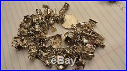 Sterling silver old bracelet with 40 charms 143 grams house dog concorde n/scrap