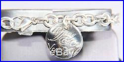 Tiffany & Co. New York Notes Round Tag 7 Sterling Silver Bracelet Charm