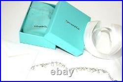 Tiffany & Co S/Silver Tiffany & Co charm bracelet 7.75 long