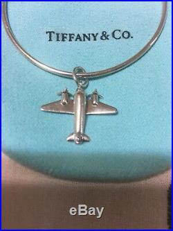 Tiffany & Co. Sterling Silver Bangle Bracelet With Airplane Charm. Authentic