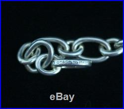 Tiffany & Co. Sterling Silver Oval Clasping Link Charm Bracelet 7in. End Clasps