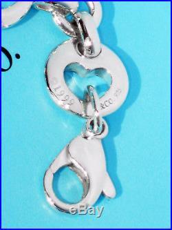 5ecdf72316135 Tiffany & Co Sterling Silver Stencil Pierced Heart Charm Bracelet ...