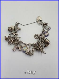 Vintage Antique Sterling Silver Charm Bracelet with 24 Silver Charms. 63 grams