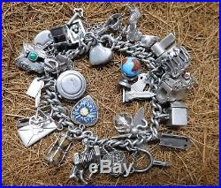 Vintage Heavy Sterling Silver Charm Bracelet With 30 Charms 2 Ounces of Silver