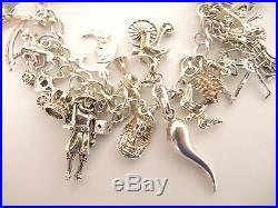 Vintage Heavy Sterling Silver Charm bracelet 30 plus charms 49grams