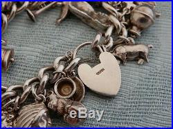 Vintage Ladies 100g Sterling Silver Charm bracelet with 34 original charms