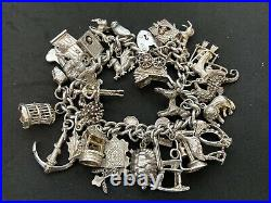 Vintage Sterling Silver Charm Bracelet with 30 Silver Charms. 80 grams