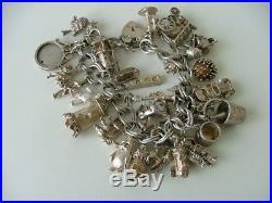 Vintage sterling silver charm bracelet with 27 charms Birmingham hallmark 1977