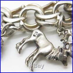 Vtg 835 Silver Assorted Dangling Charm Bracelet 7