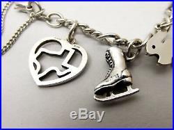 Vtg James Avery Sterling Silver 12 Charm Bracelet Dog Cat Swimmer Moon Texas